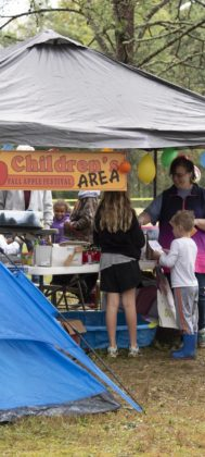 Families gather at the Apple Festival's children's activities area.