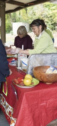 Church members cook and serve food at the Apple Festival.