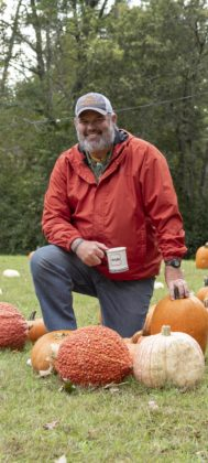 Pastor Joe Phillips poses in the pumpkin patch at Norwood United Methodist Church.