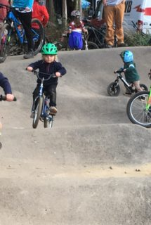 Brothers Sam, 6, and Ryan Cherry, 5, lead the pack on the kids' pump track at Baker Creek Preserve.